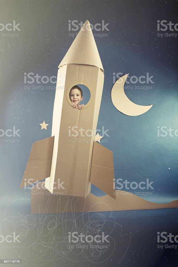 Spaceflight in paper rocket stock photo