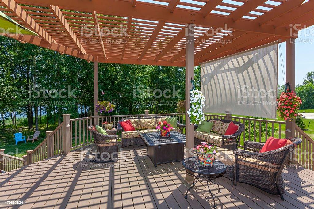 Spacious Backyard Patio Deck With Pergola stock photo