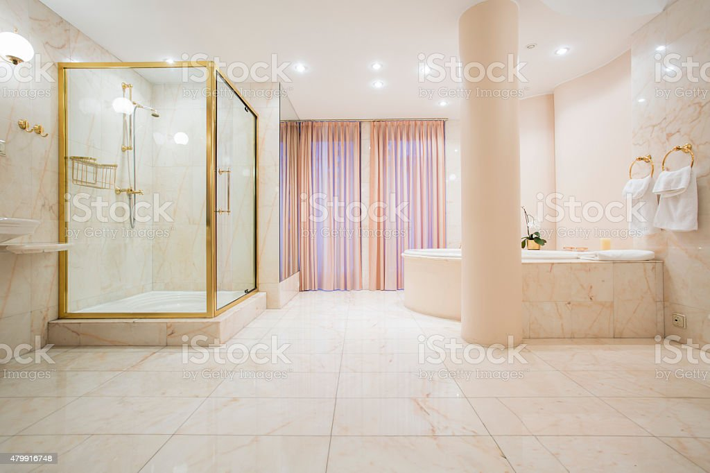 Spacious bathroom in luxury mansion stock photo