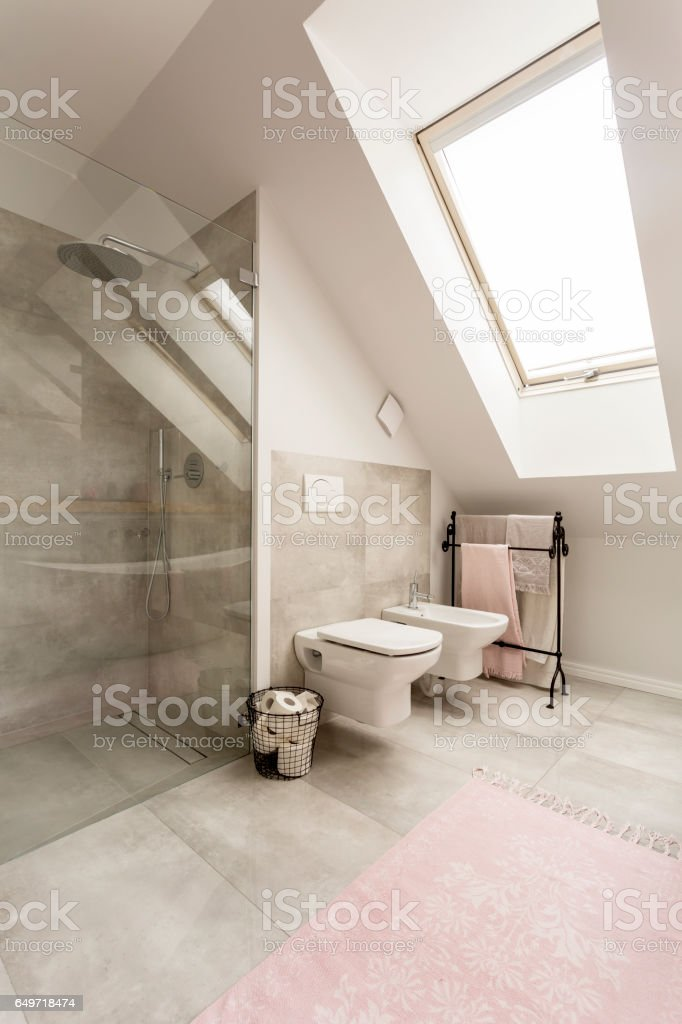 Spacious bathroom with glass shower stock photo