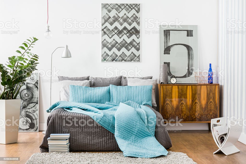 Spacious bedroom with modern furniture stock photo