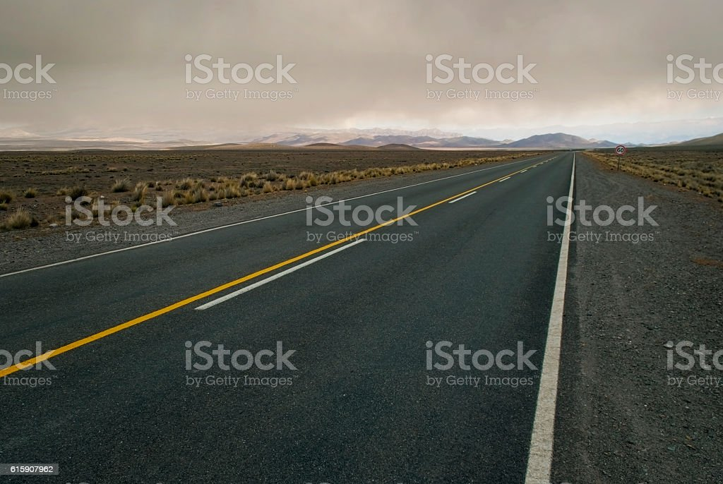 Spacious cloudy landscape crossed by empty road stock photo