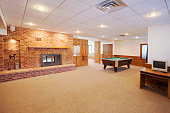 Spacious finished basement with pool table, fire place.