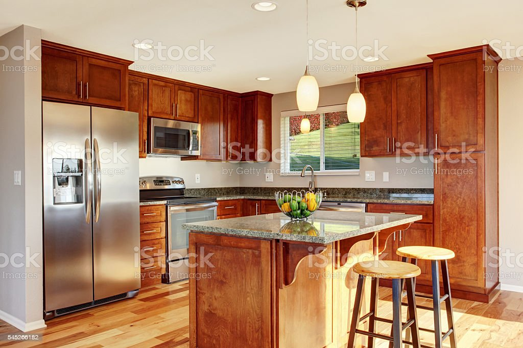 Spacious kitchen room with bar, stainless steel appliances stock photo