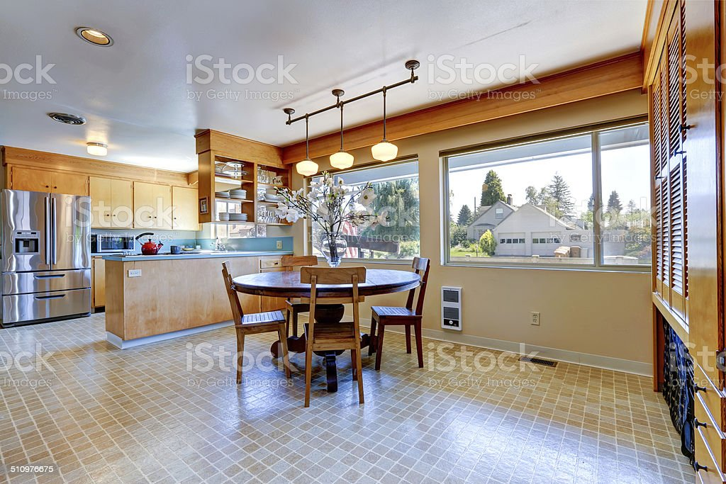 Spacious kitchen room with round dining table stock photo