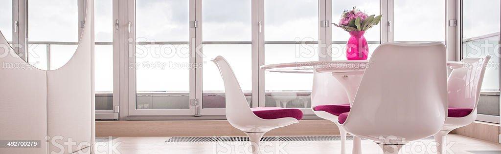 Spacious lounge with window wall stock photo