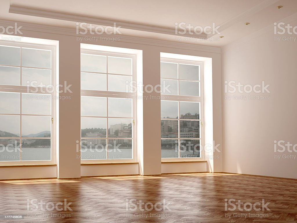 Spacious room with three large windows royalty-free stock photo