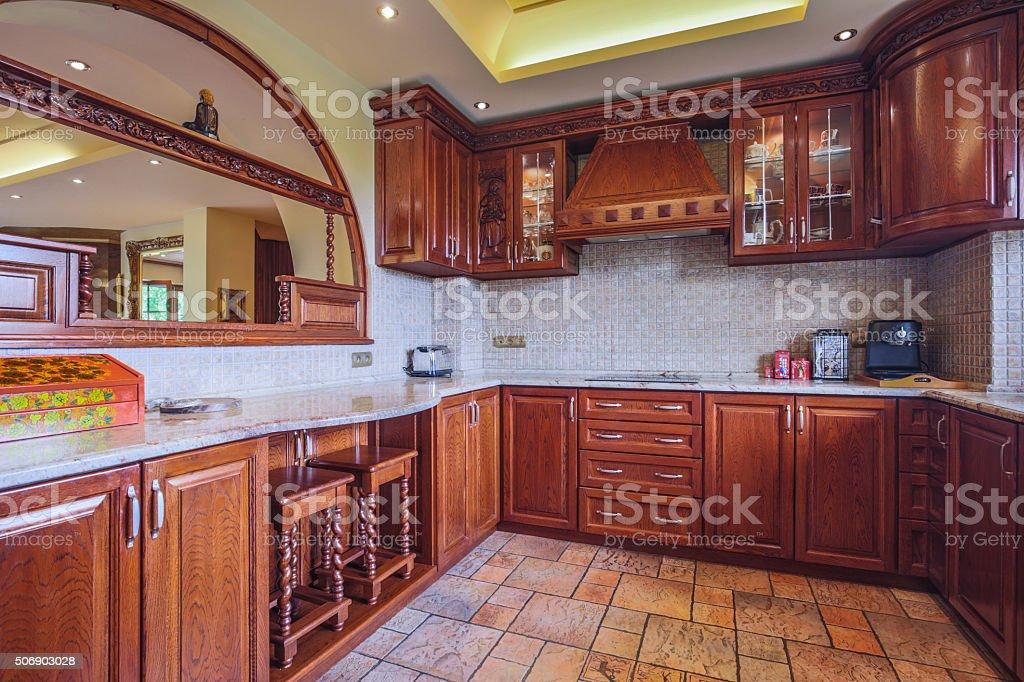 Spacious wooden kitchen interior stock photo