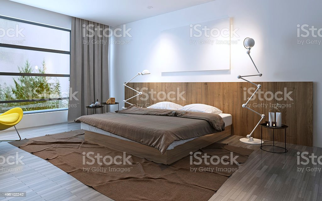 Spacy bedroom with double bed stock photo