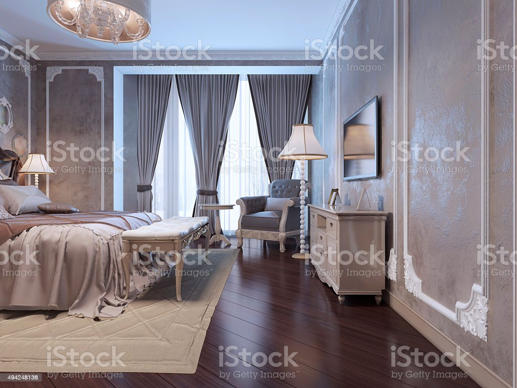 Spacy bedroom with large window stock photo