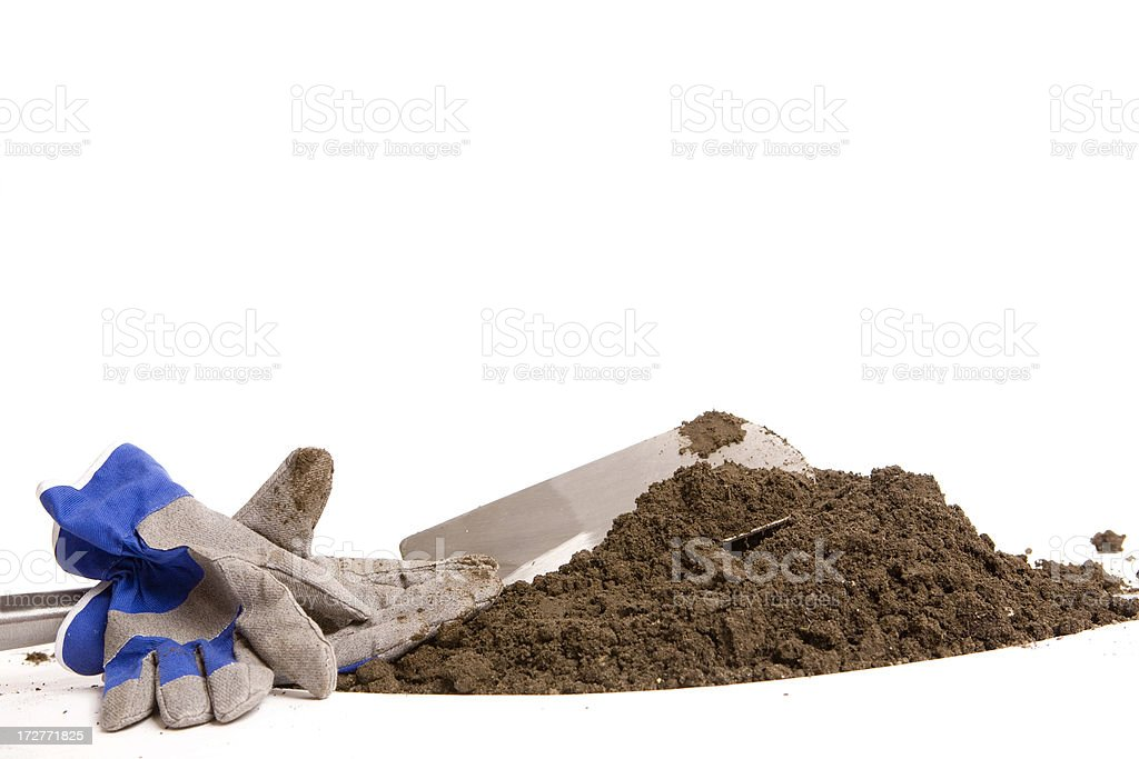 Spade and gloves on a white background. royalty-free stock photo