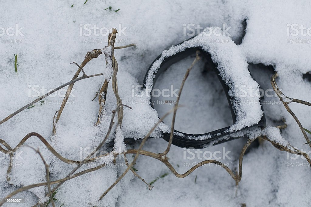 Spade Handle in the Snow stock photo