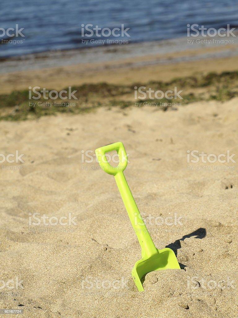 Spade on the beach royalty-free stock photo