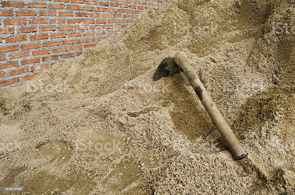 Spade on the sand stock photo