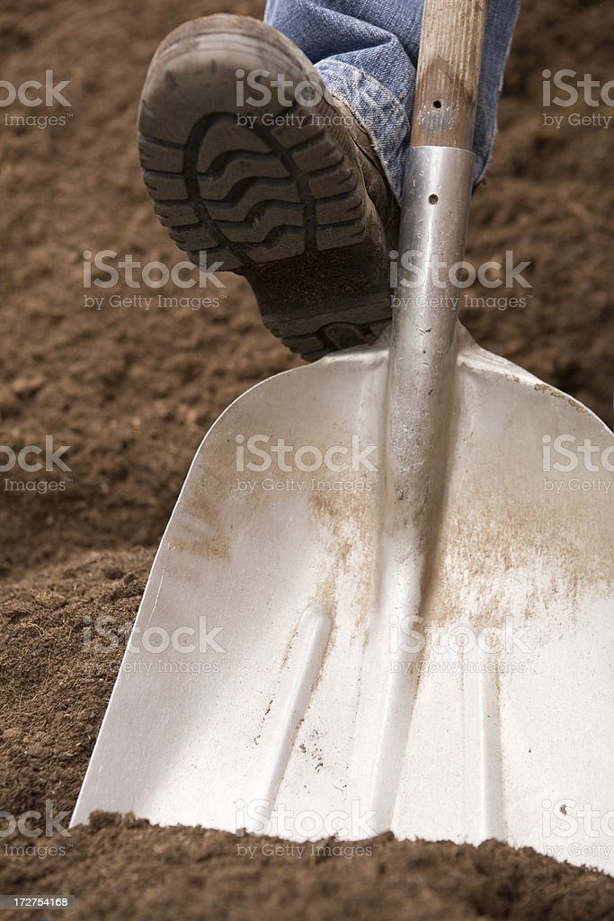 Spade with boot royalty-free stock photo