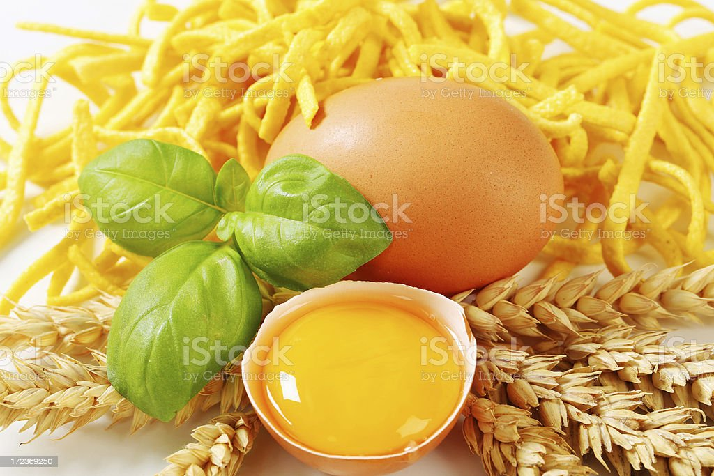 Spaetzle noodles with raw egg royalty-free stock photo