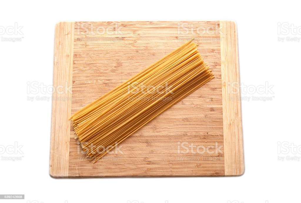spagetti isolated on wooden surface stock photo