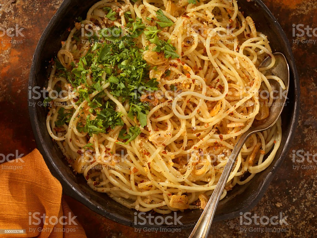 Spaghetti Aglio e Olio with Fresh Parsley stock photo