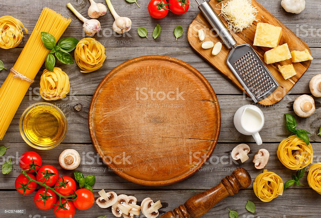 Spaghetti and fettuccine with ingredients for cooking pasta stock photo