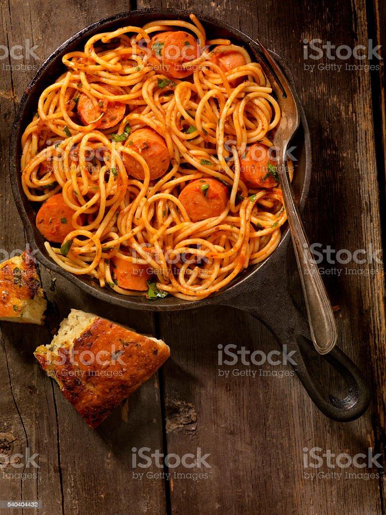 Spaghetti and Hotdogs in Tomato Sauce stock photo