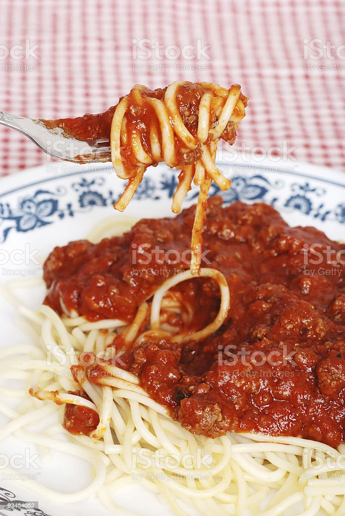 spaghetti and meat sauce on a fork royalty-free stock photo