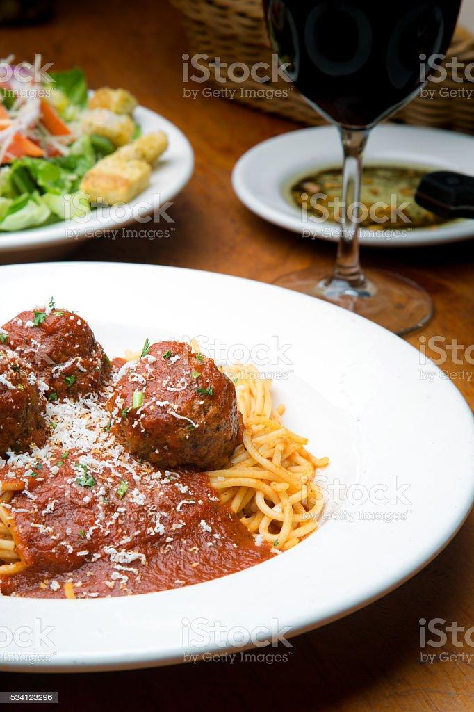 Spaghetti And Meatballs In Marinara Sauce With Side Salad stock photo