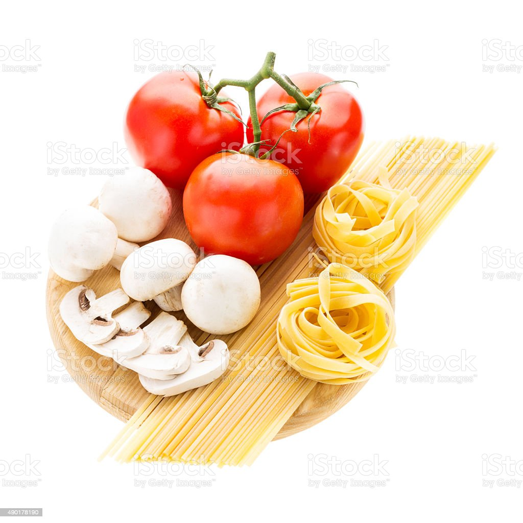 Spaghetti and nest pasta with vegetables stock photo