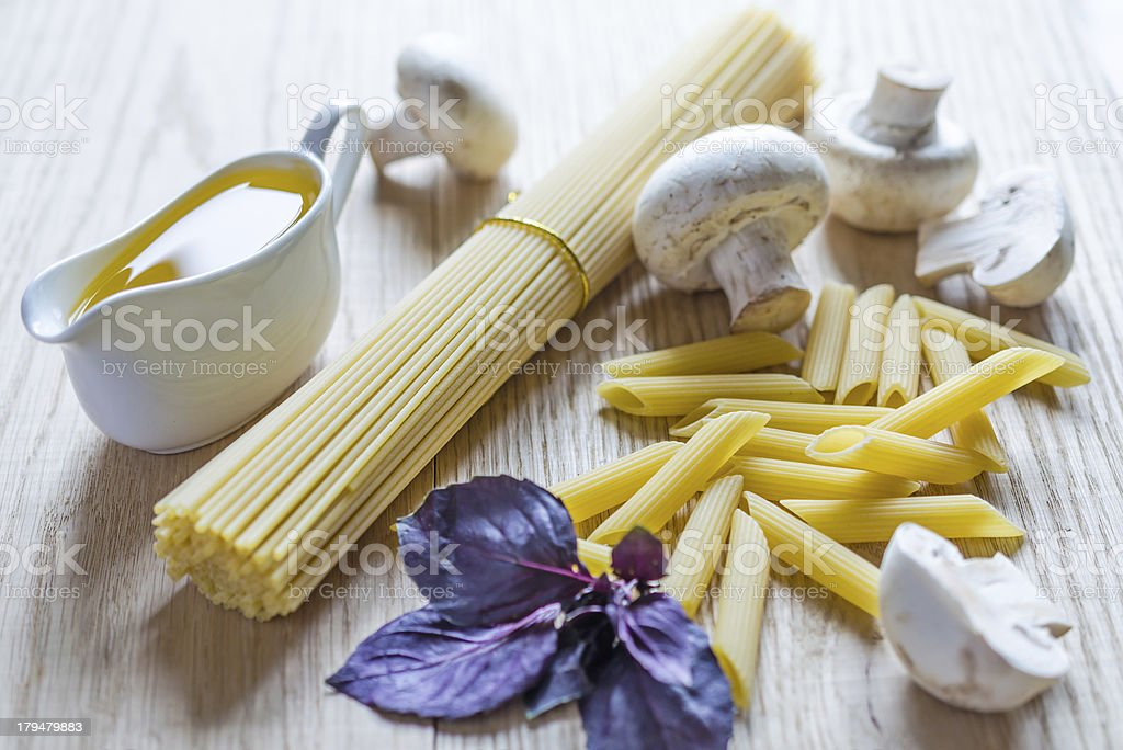 Spaghetti and penne with pasta ingredients royalty-free stock photo