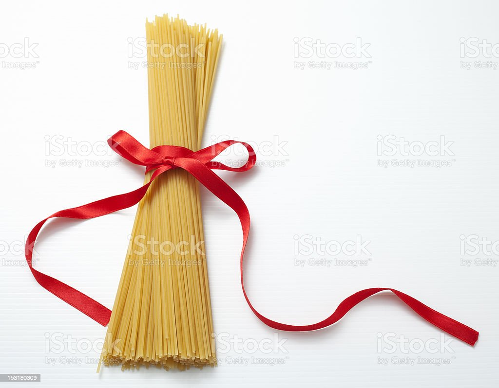 Spaghetti and red bow. royalty-free stock photo