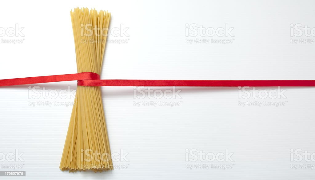 Spaghetti and red ribbon. royalty-free stock photo