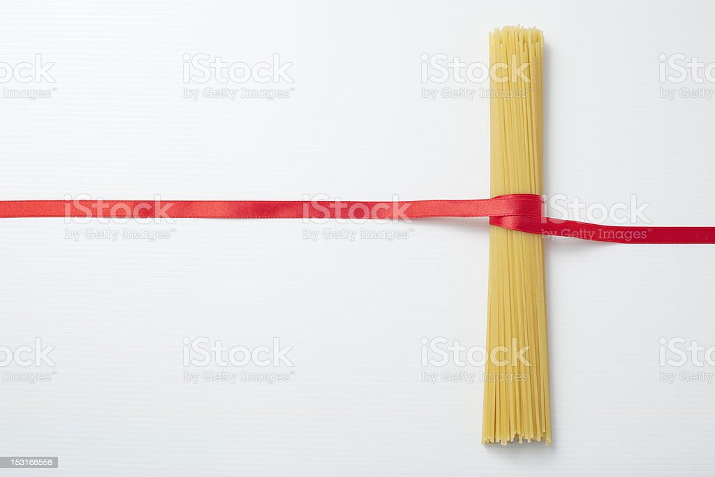 Spaghetti and ribbon. royalty-free stock photo