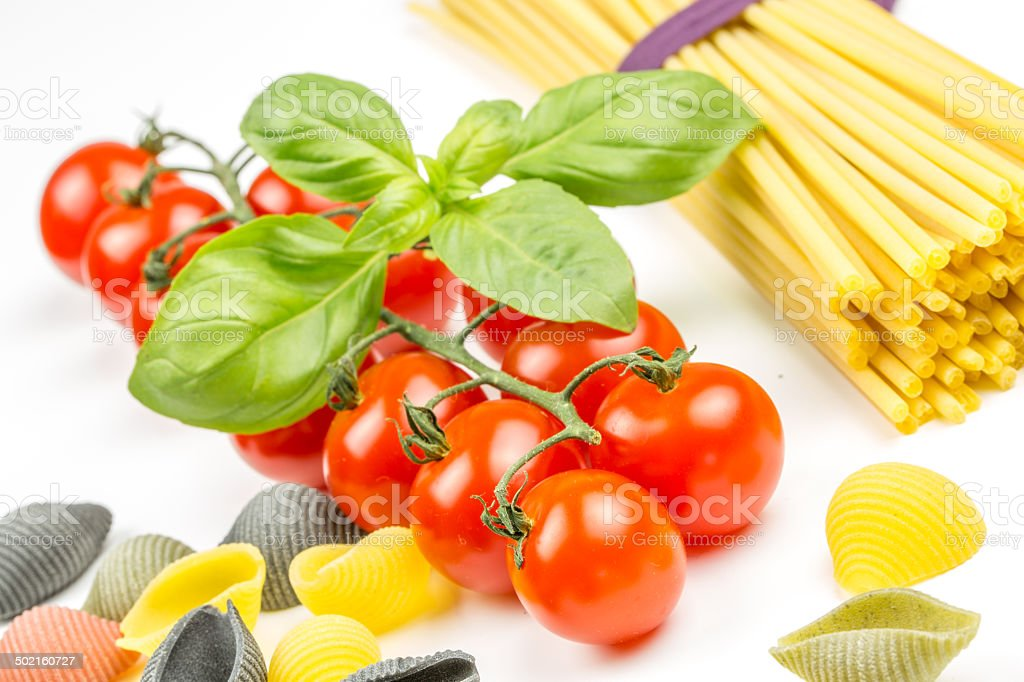 Spaghetti and tomatoes with basil royalty-free stock photo