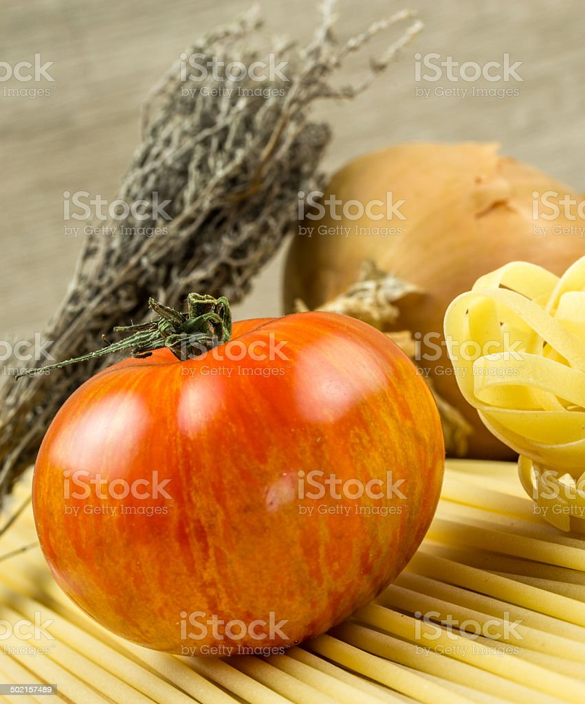 Spaghetti and tomatoes with herbs royalty-free stock photo