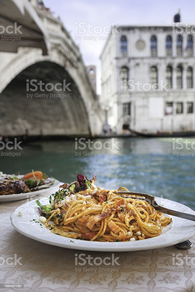 Spaghetti at the Rialto Bridge, Venice. royalty-free stock photo