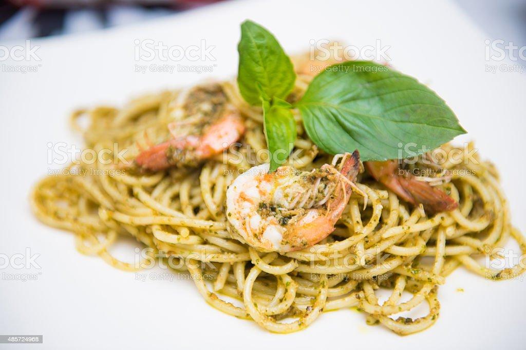 spaghetti basil sauce with shimp stock photo