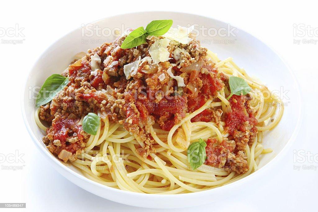 Spaghetti Bolognese in a white bowl stock photo