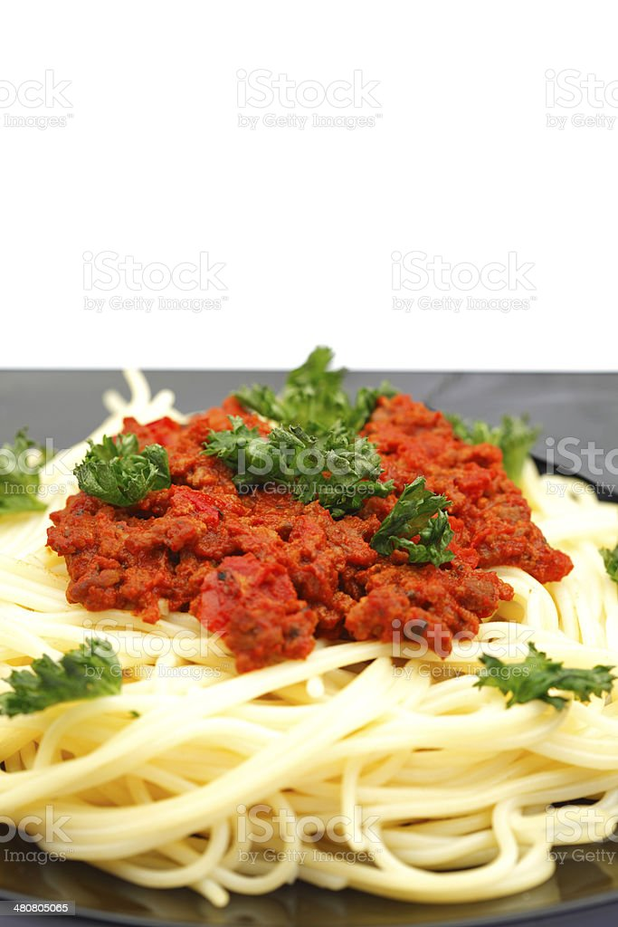 Spaghetti bolognese on black plate royalty-free stock photo
