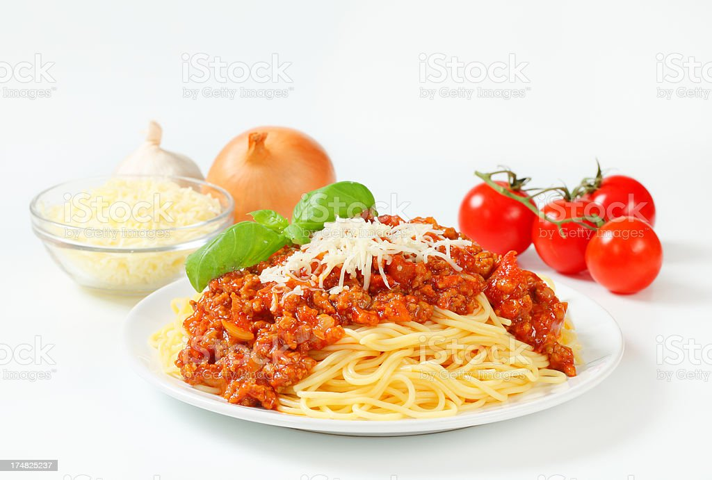 spaghetti bolognese with cheese and vegetables royalty-free stock photo