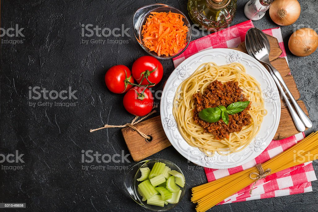 Spaghetti bolognese with ingredients stock photo