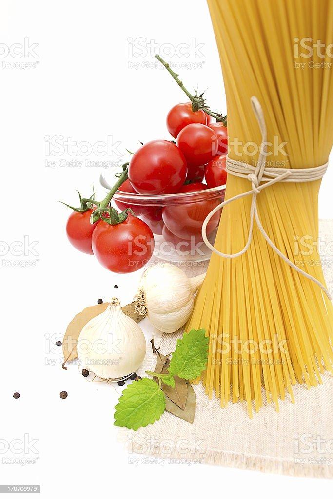 spaghetti, cherry tomatoes, onions royalty-free stock photo