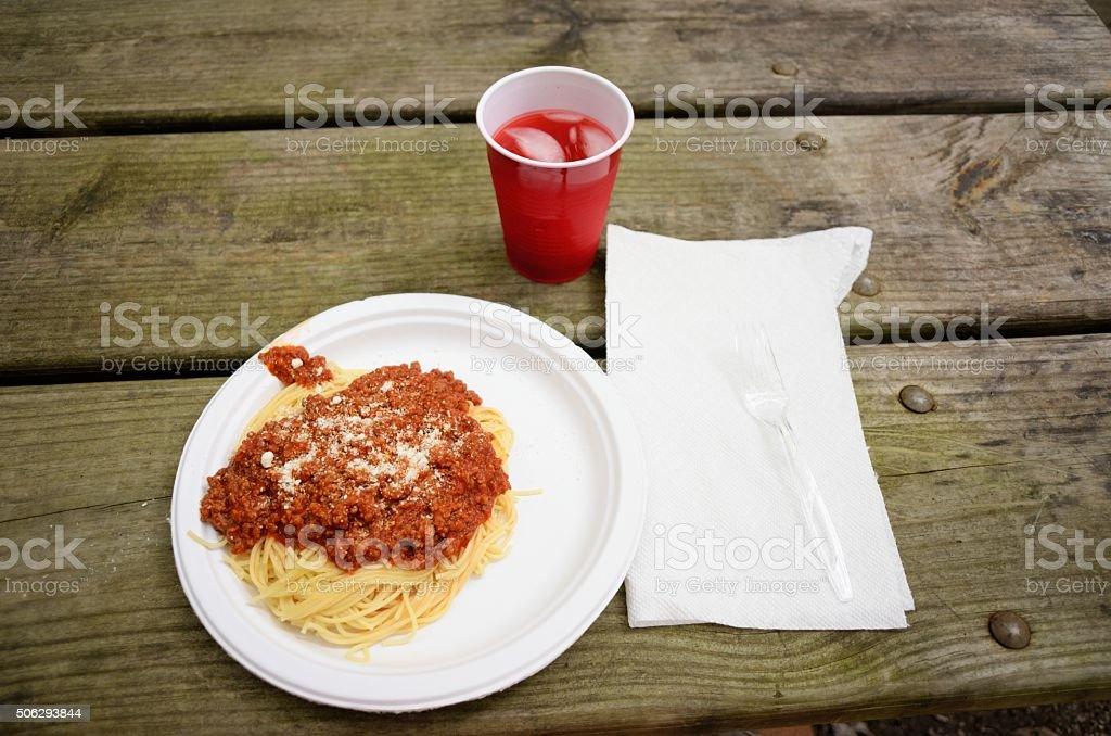 Spaghetti dinner on the picnic table stock photo