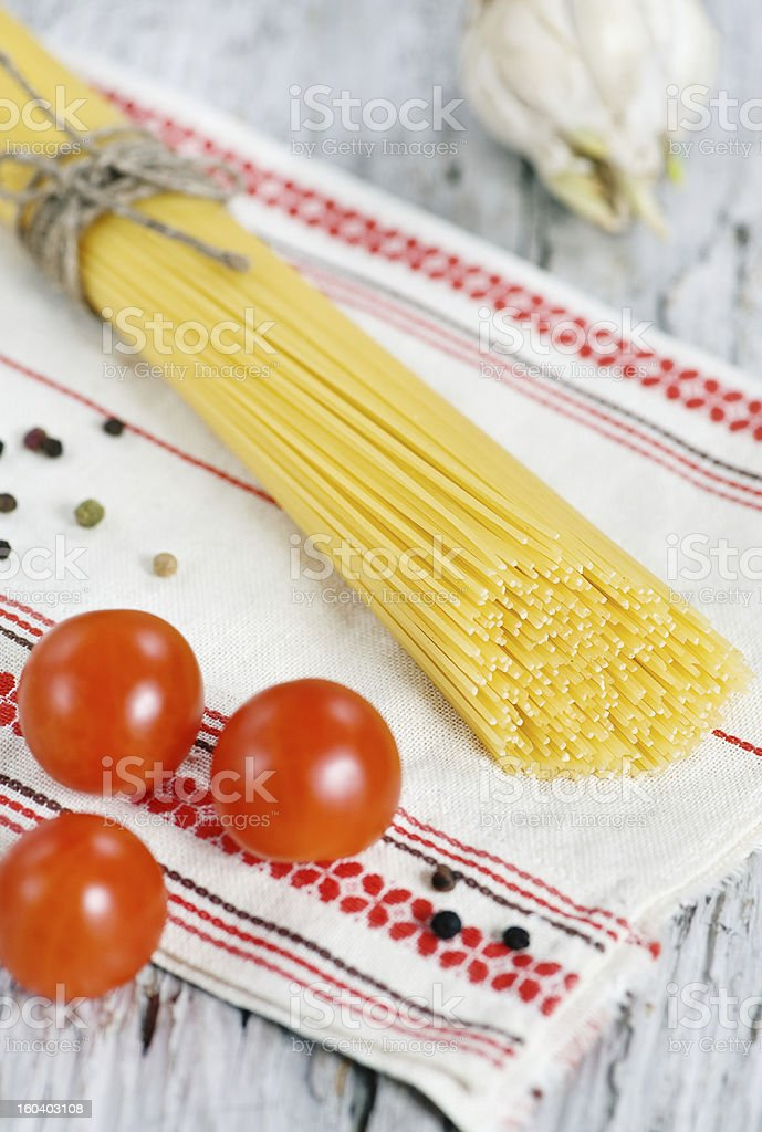 Spaghetti, dry pepper, tomatoes and garlic royalty-free stock photo