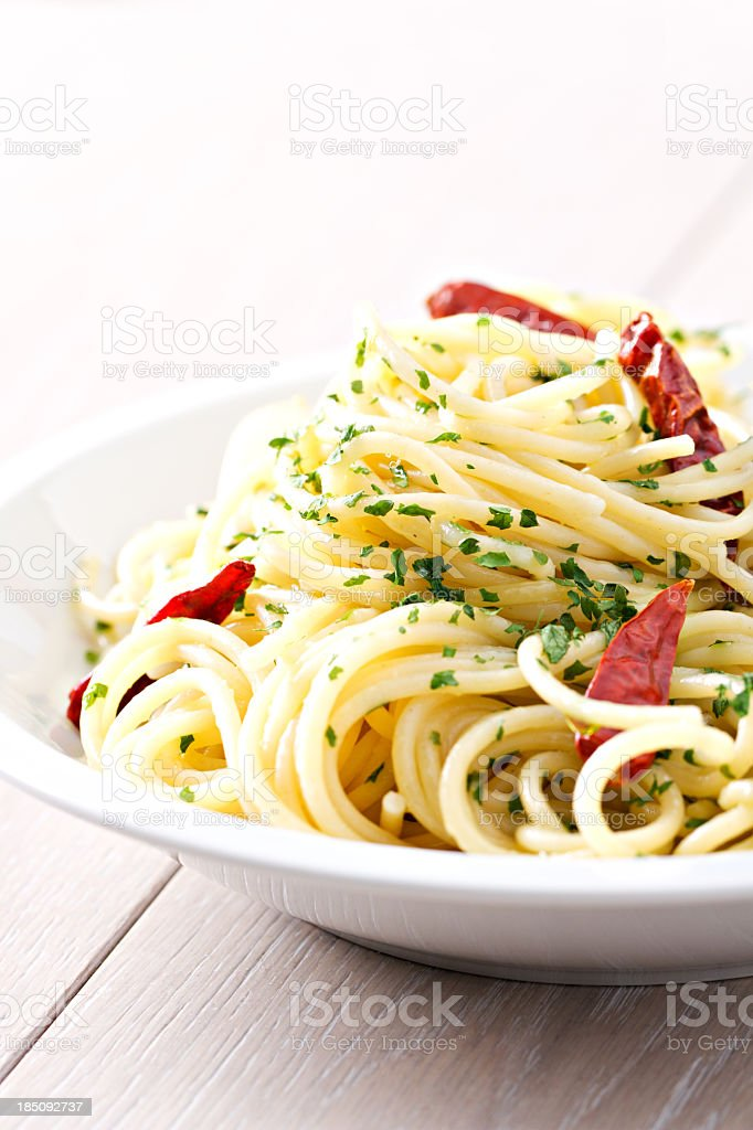 Spaghetti garlic oil and red chili pepper royalty-free stock photo