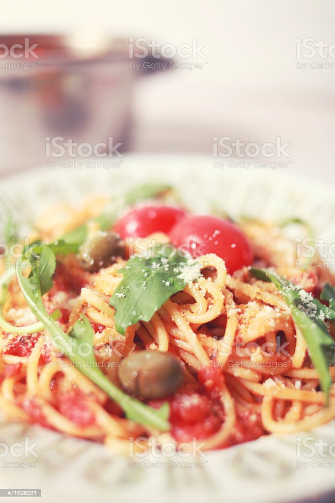 Spaghetti in creamy tomato sauce with cheese royalty-free stock photo
