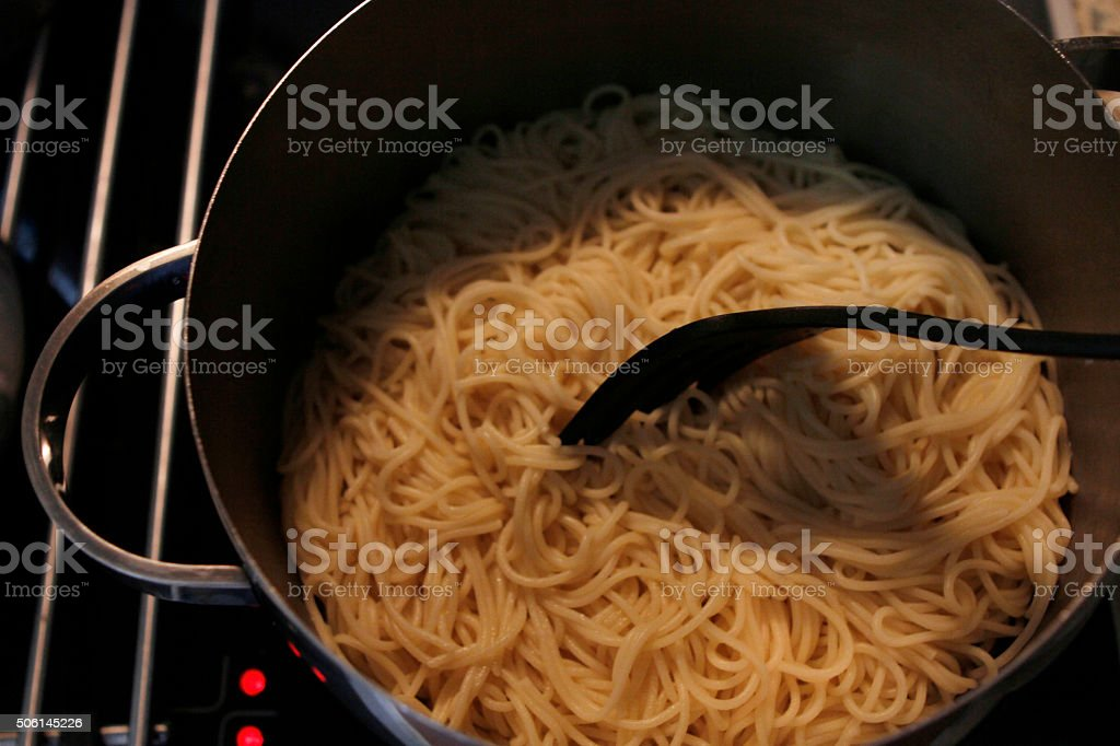 spaghetti in saucepan stock photo