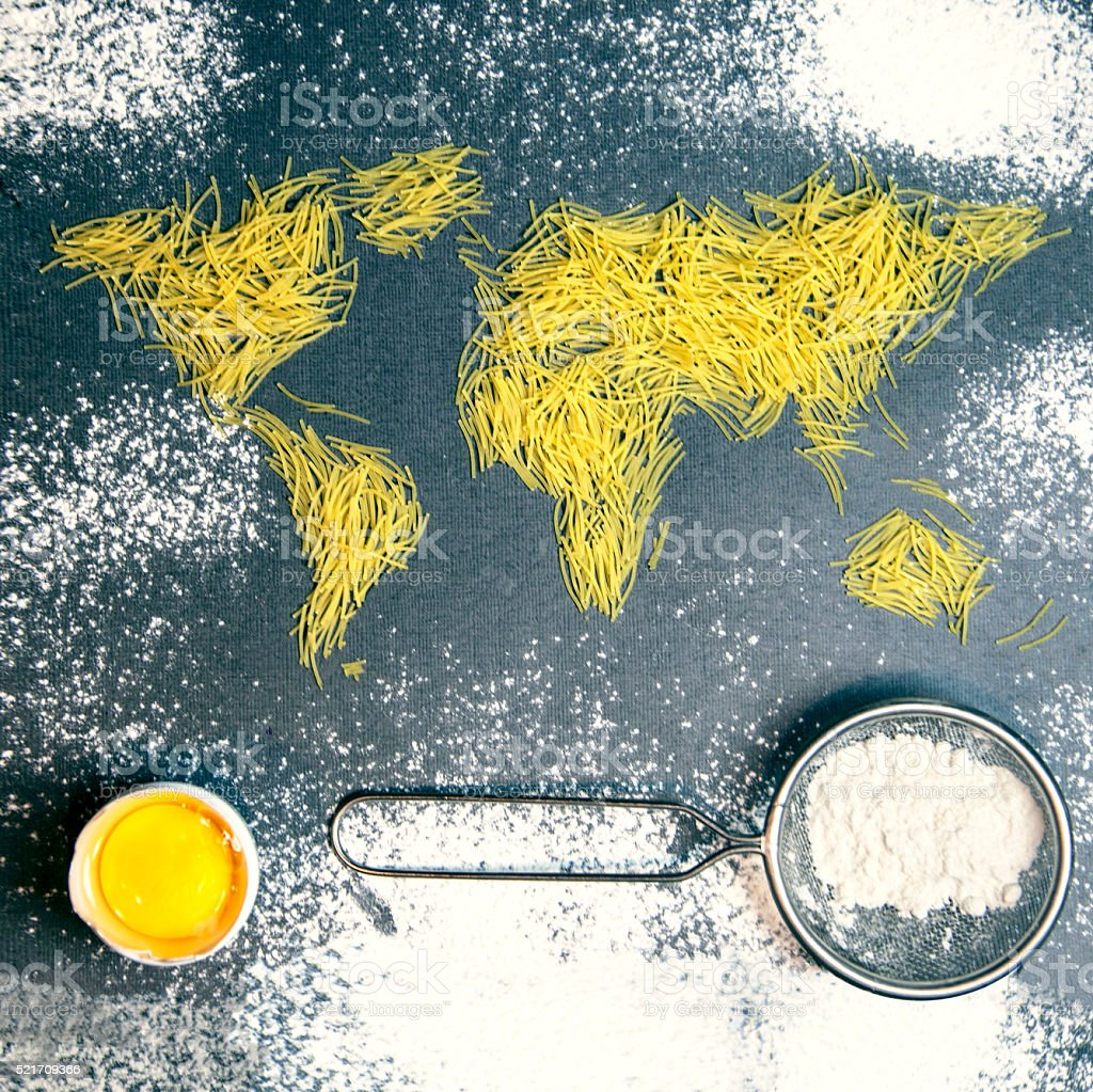 spaghetti in the form of a world map, egg, flour stock photo