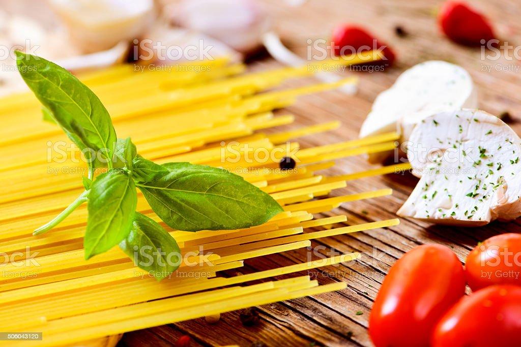 spaghetti, mushrooms and cherry tomatoes stock photo