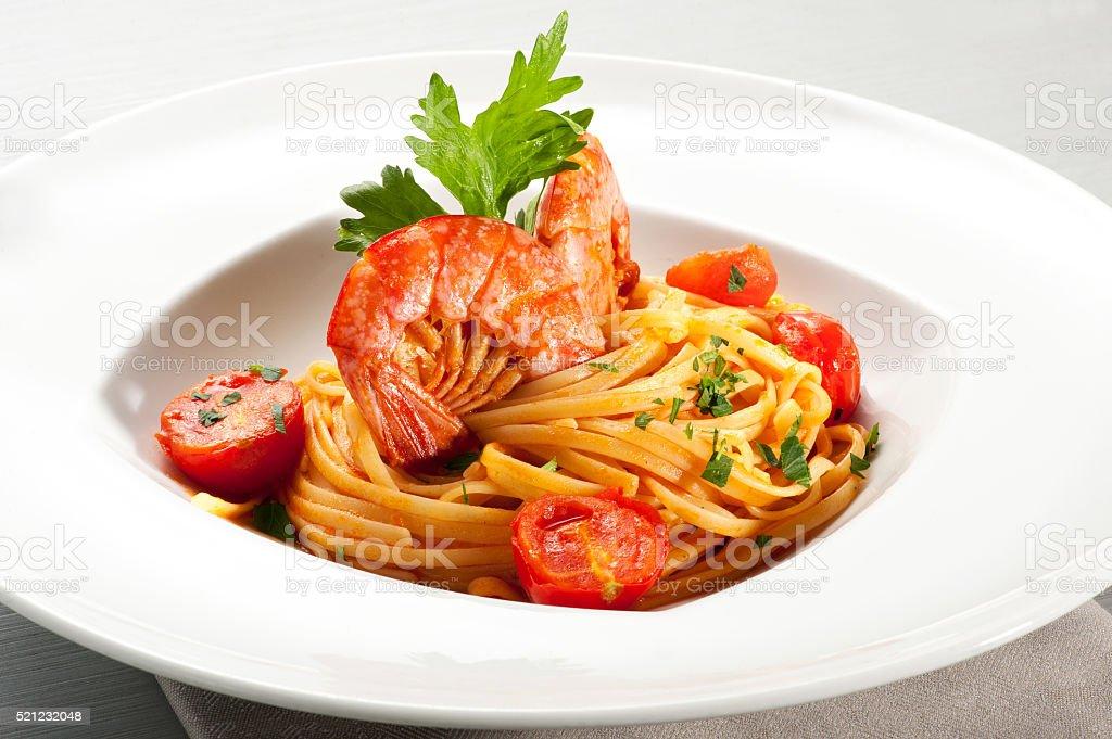 Spaghetti noodles with prawn on top stock photo