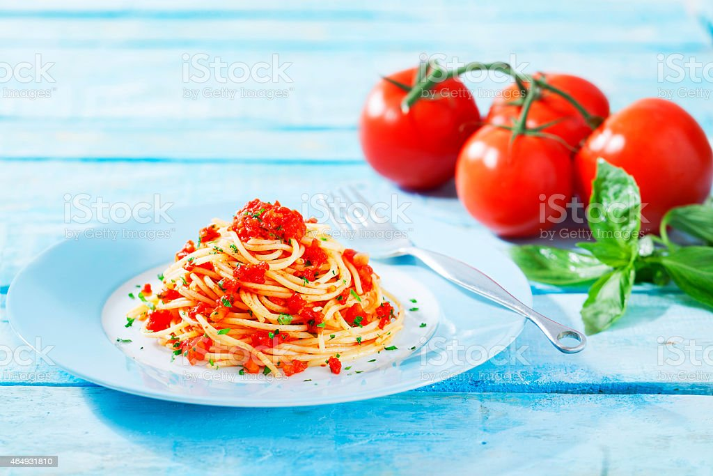 Spaghetti on the wooden table stock photo
