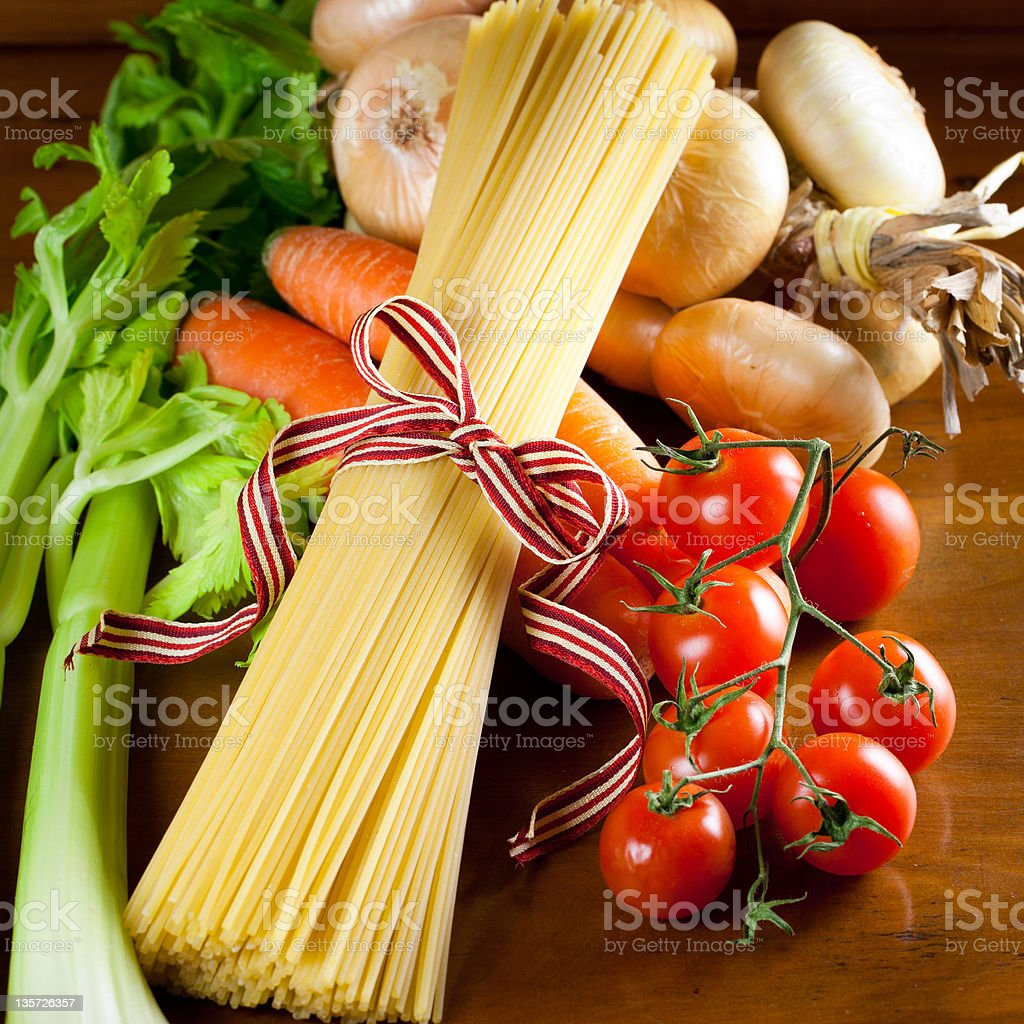 Spaghetti pasta and ingredients fot tomato sauce royalty-free stock photo